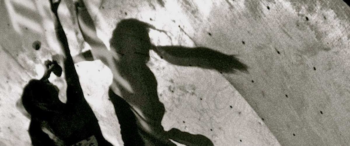Woman indoor rock climbing