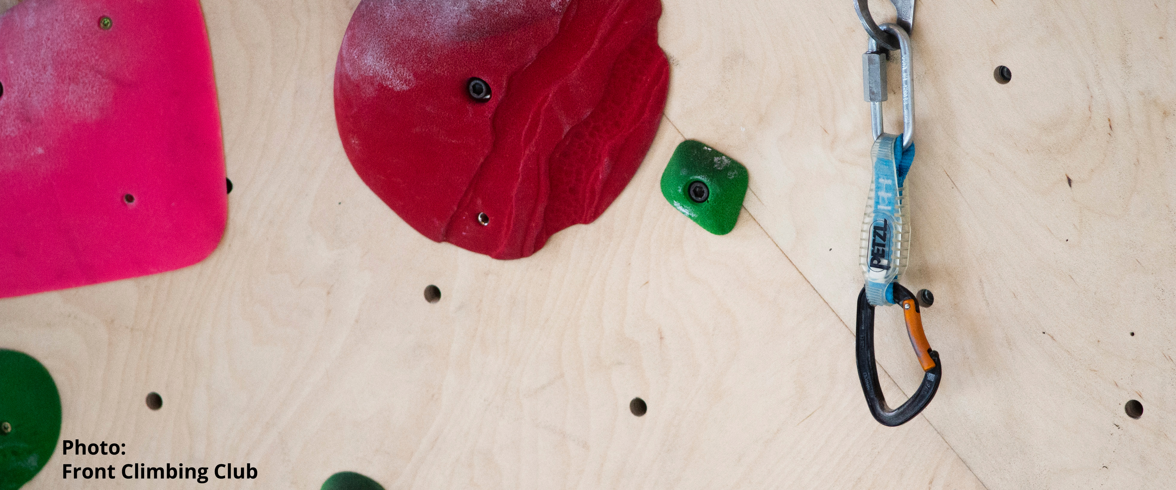 A route in a climbing gym with a quickdraw