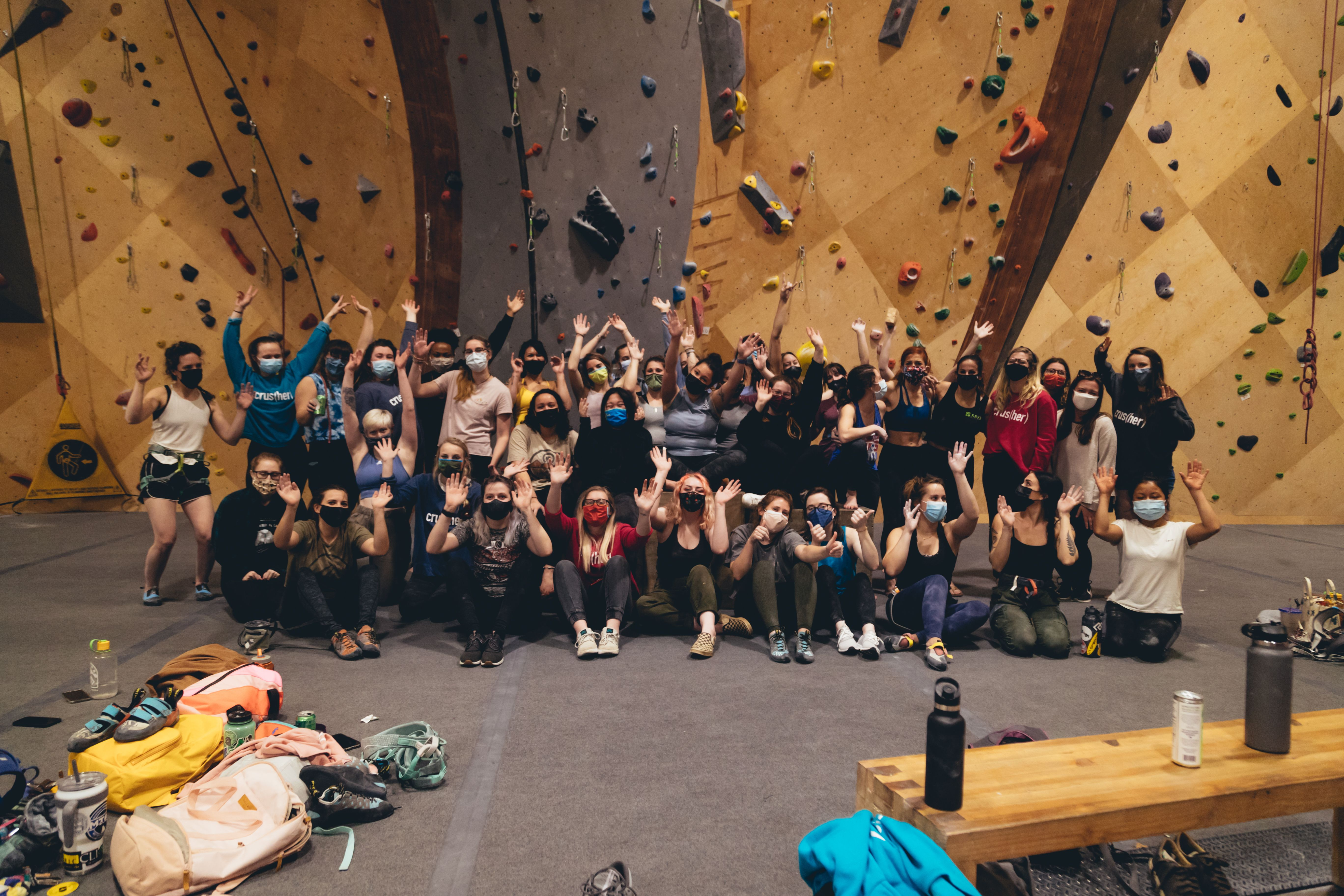 Group indoor climbers wearing masks