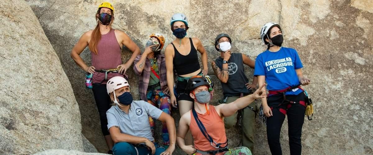 Outdoor rock climbers wearing masks