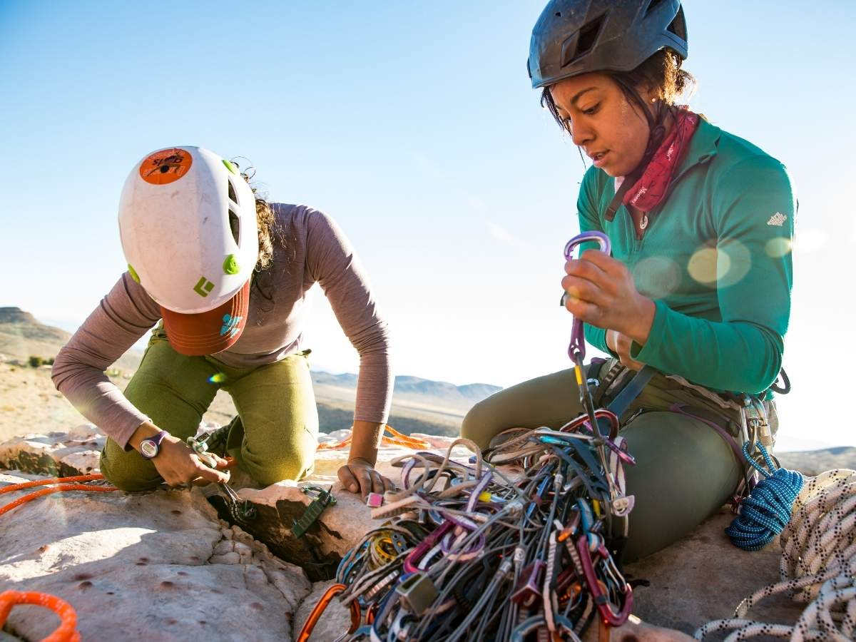 two rock climbers working with trad gear outside