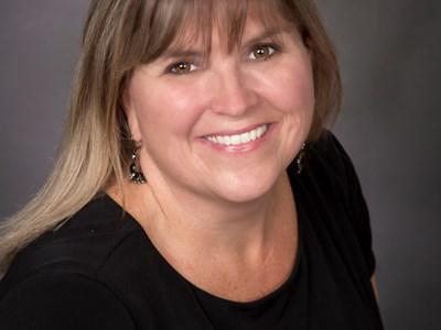 Debra May