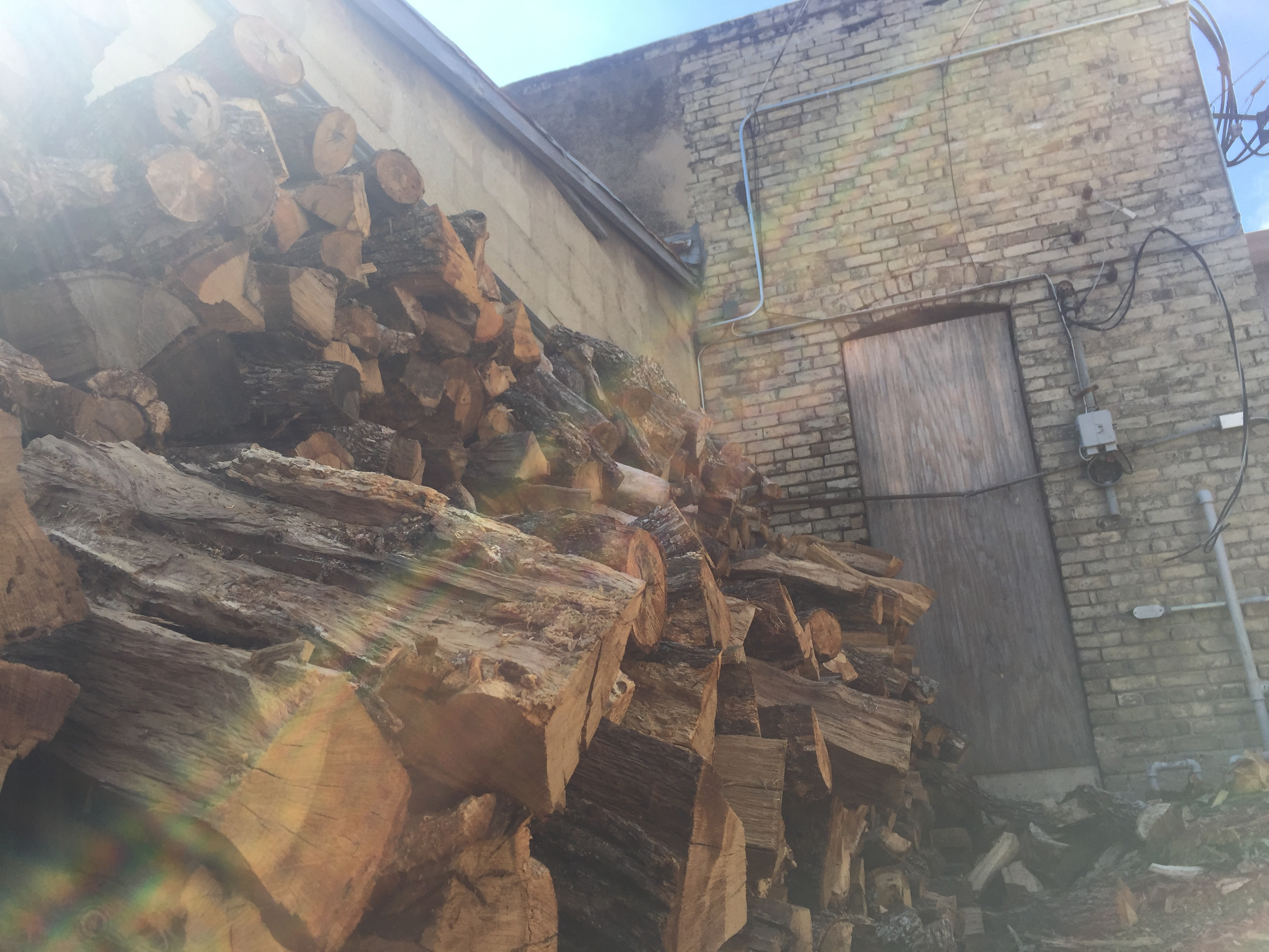 Wood pile by Louis Mueller BBQ. Photo by Stover Harger III