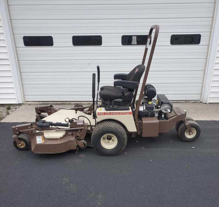 Riding mower in front of garage